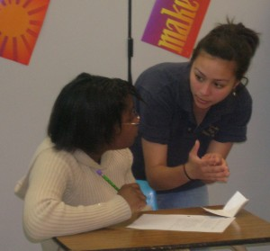 An experienced debater offers advice to a beginner   at DKC school support visit