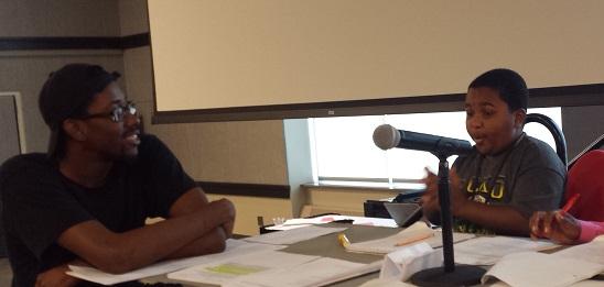 DKC & Central grad Taylor Dias mentoring a young debater